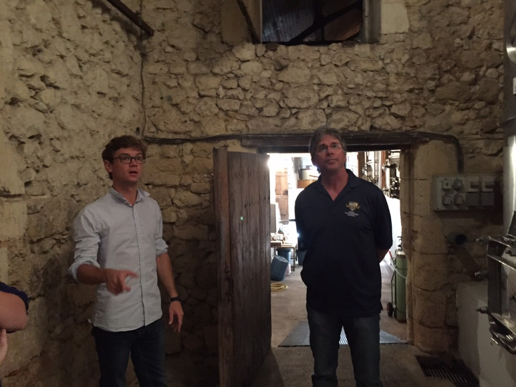 Winemaker/Export Manager Thomas Le Grix de la Salle showing the winery to Eddie Bushman.