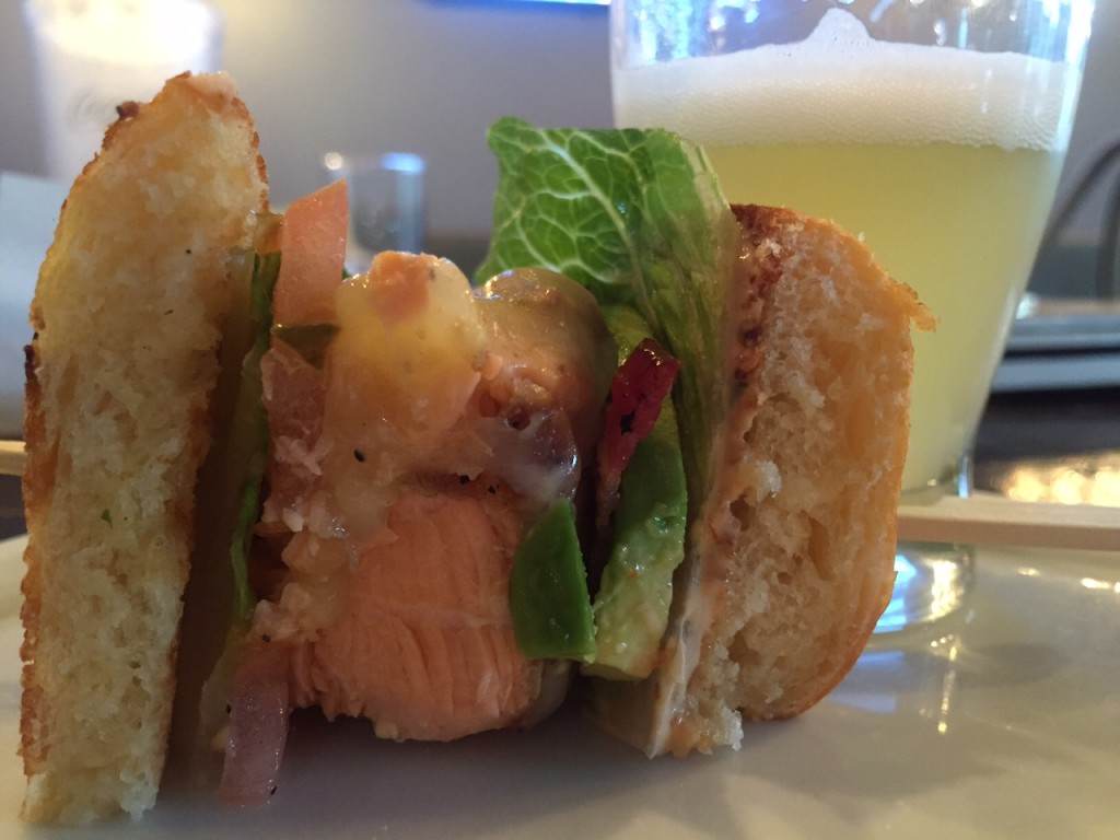 Salmon burger on brioche with an Allagash White